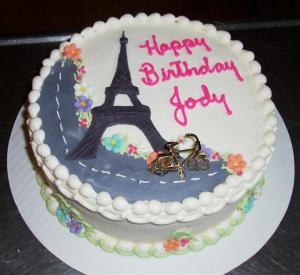 Yellow butter cake, vanilla frosting,fondant Eiffel Tower.Bicycle charm.